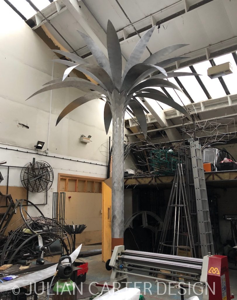 Julian Carter Design. A palm tree being set up in the studio prior to painting