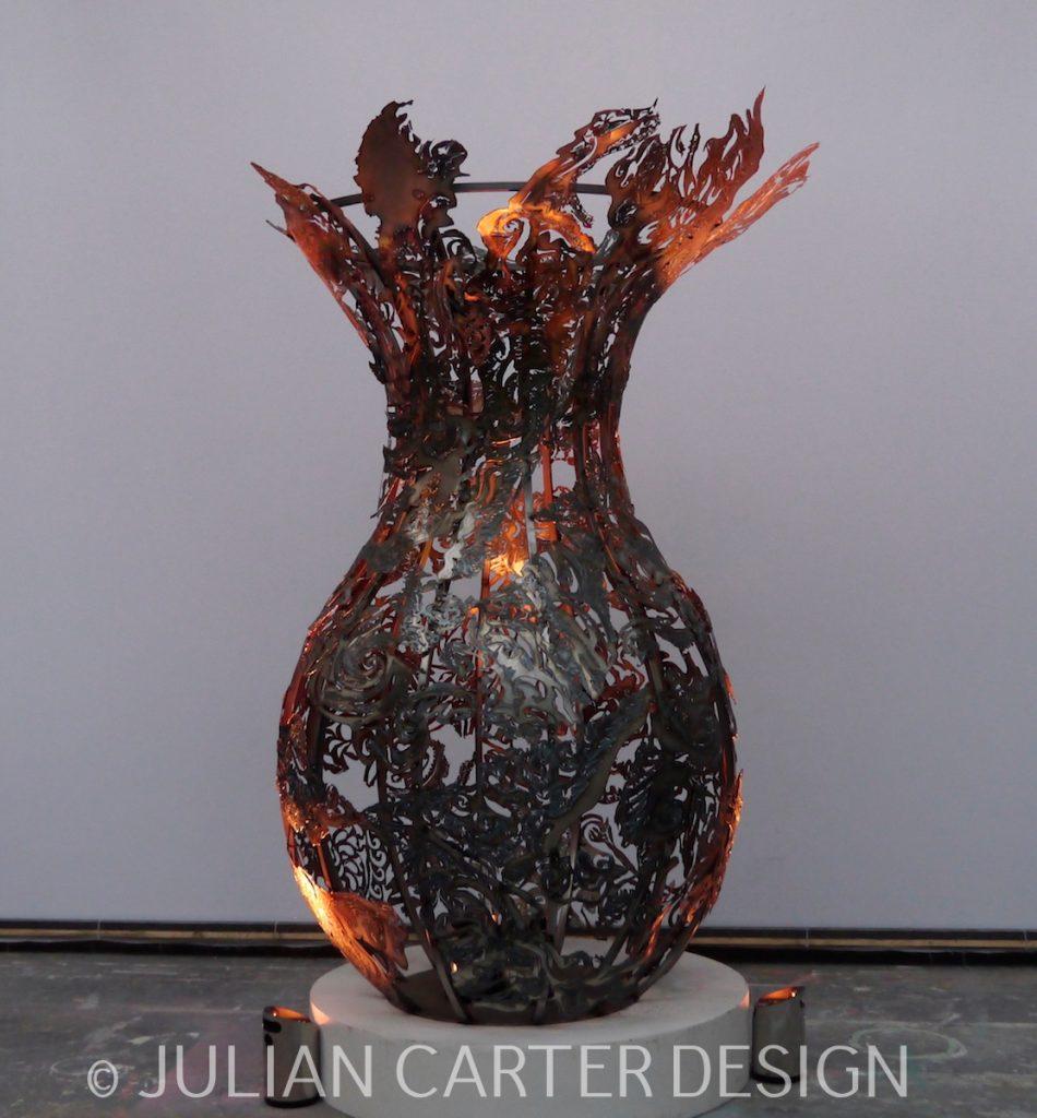 Julian Carter Design. 8' steel vase with under-lighting.