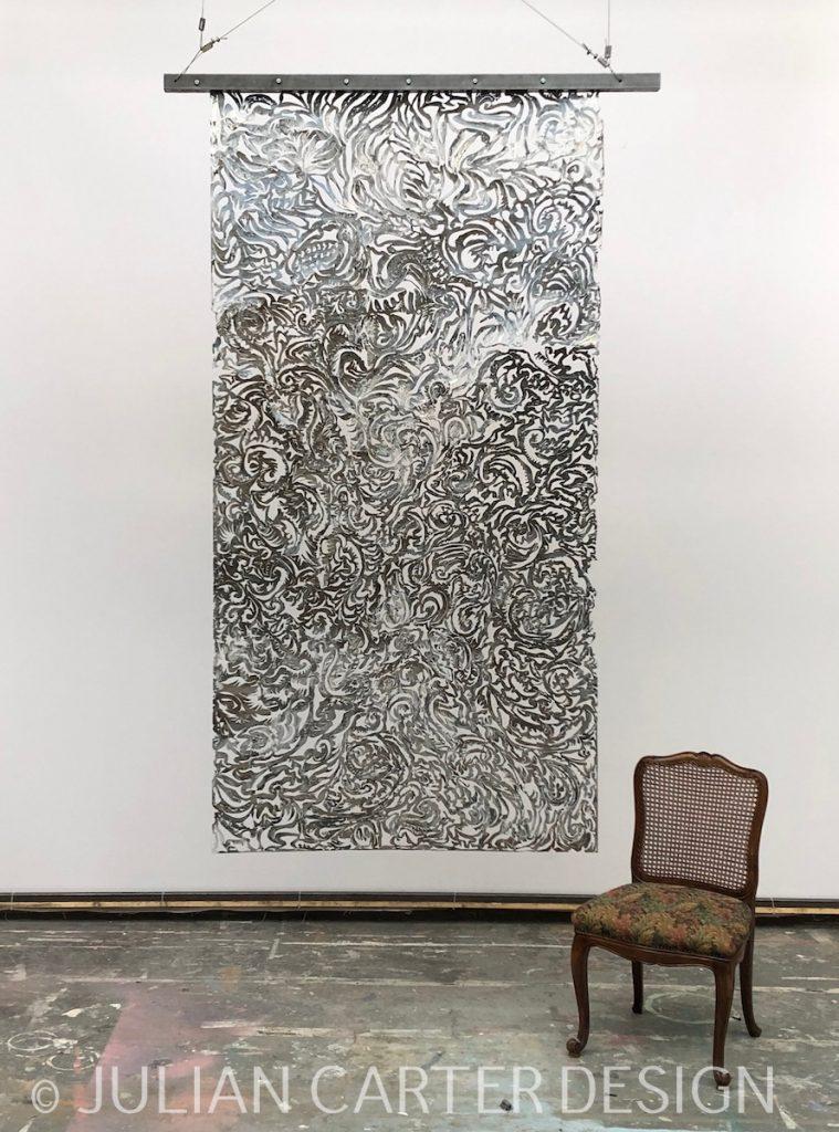 Julian Carter Design. Suspended steel textile screen. Polished side.