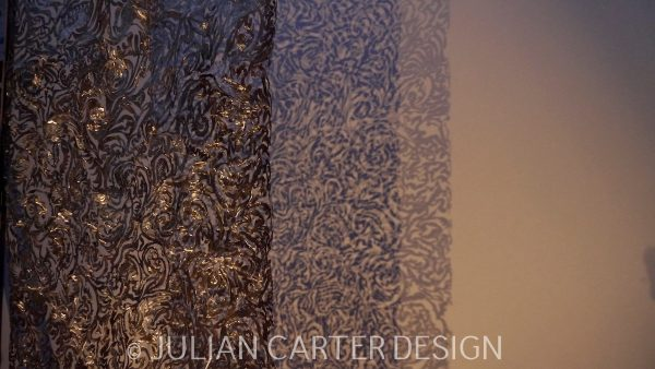 Julian Carter Design. A section of the suspended steel textile screen with a double shadow
