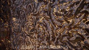 Julian Carter Design. Close up of steel textile screen. Polished side.