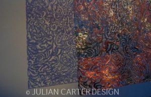Julian Carter Design. Detail of textile inspired screen - under lit in detail.
