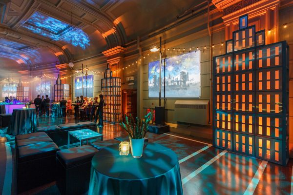 Julian Carter Design. Light boxes, 3 metre city scape murals, bars and seating. Cirque Du Soleil hospitality.